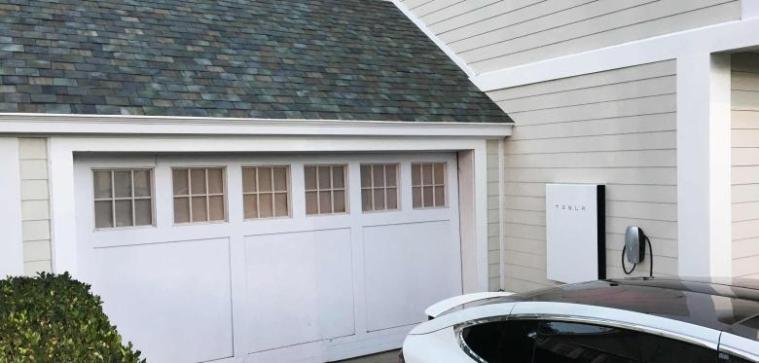 tesla-s-electric-car-powerwall-and-solar-roof-are-shown-at-an-un-2